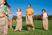 Children potato sack racing