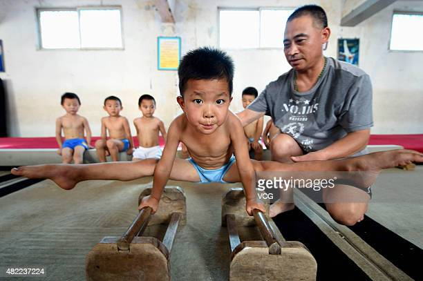 Children practice during a gymnastics summer school on July 28 2015 in Bozhou Anhui Province of China
