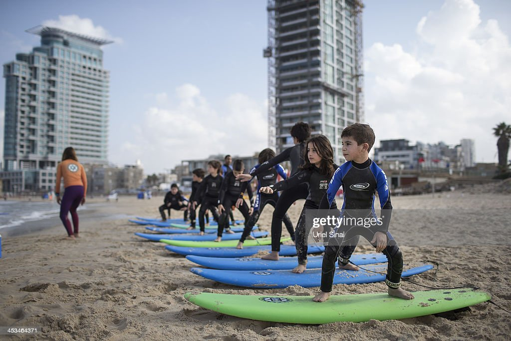 Children practice on the beach as they spend the Jewish holiday of Hanukkah, the festival of light, at the 'Israeli surf club' surf camp on December 4, 2013. in Tel Aviv, Israel. Over 1,500,000 Israeli children are on a week long holiday from schools for Hanukkah a holiday that commemorates the re-dedication of the Jewish Temple in Jerusalem in 165 BC following the victory of the Jewish Maccabees over the Seleucid Empire when there was only enough consecrated olive oil to fuel the eternal flame in the Temple for one day but miraculously, the oil burned for eight days.