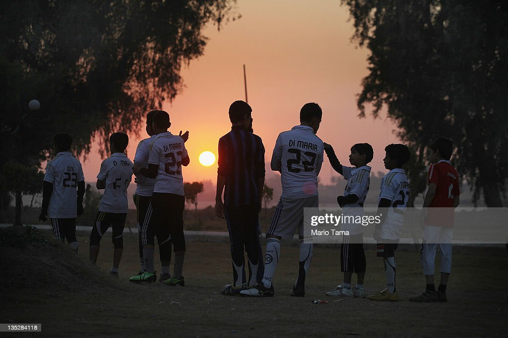 Children practice soccer at sunset on December 8, 2011 in Baghdad, Iraq. American forces are now in the midst of the final stage of withdrawal from the war-torn country with all troops scheduled to depart by December 31. At least 4,485 U.S. military personnel have died in service in Iraq. According to the Iraq Body Count more than 100,000 Iraqi civilians have died from war-related violence.