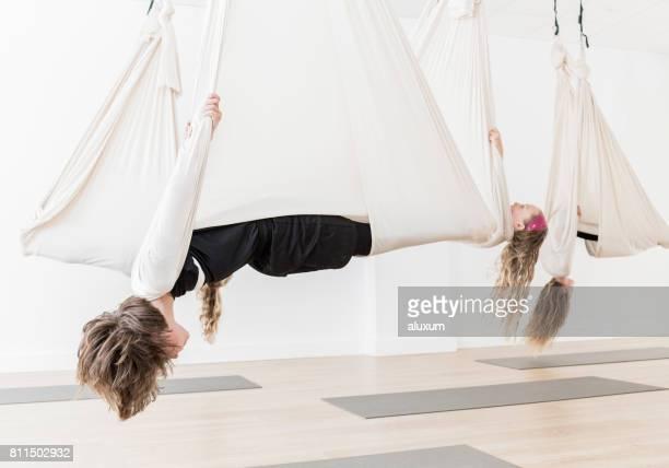 Children practicing aerial yoga