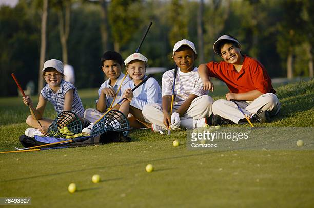 Children practicing golf