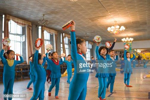 Children (6-8)  practicing in folk dance class, side view