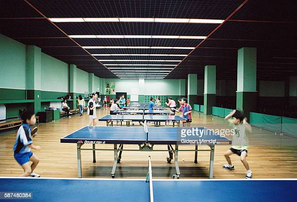 Children practise during their daily training in the table tennis hall at the Shishahai Sports School This school where around 500 young sports...