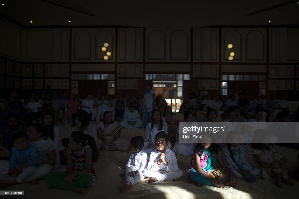 Children pray as the Jain community hold a 24 hour prayer for the victims of the Westgate Shopping Centre attack on September 28 2013 in Nairobi...