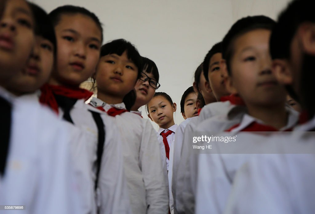 Children prepare ahead of performing during an event to celebrate International Children's Day on May 30, 2016 in Wuhan, China.