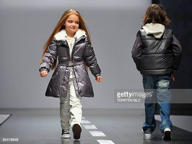 Children present fashion from the fall/winter 2009/2010 collection of the label Calvin Klein on January 23 2009 in Florence during the 'Pitti...