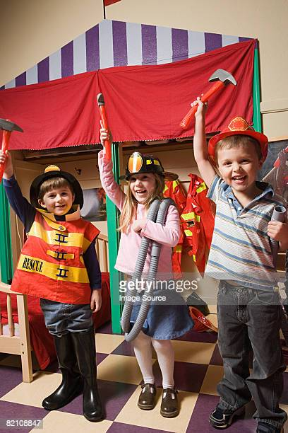 Children pretending to be firefighters