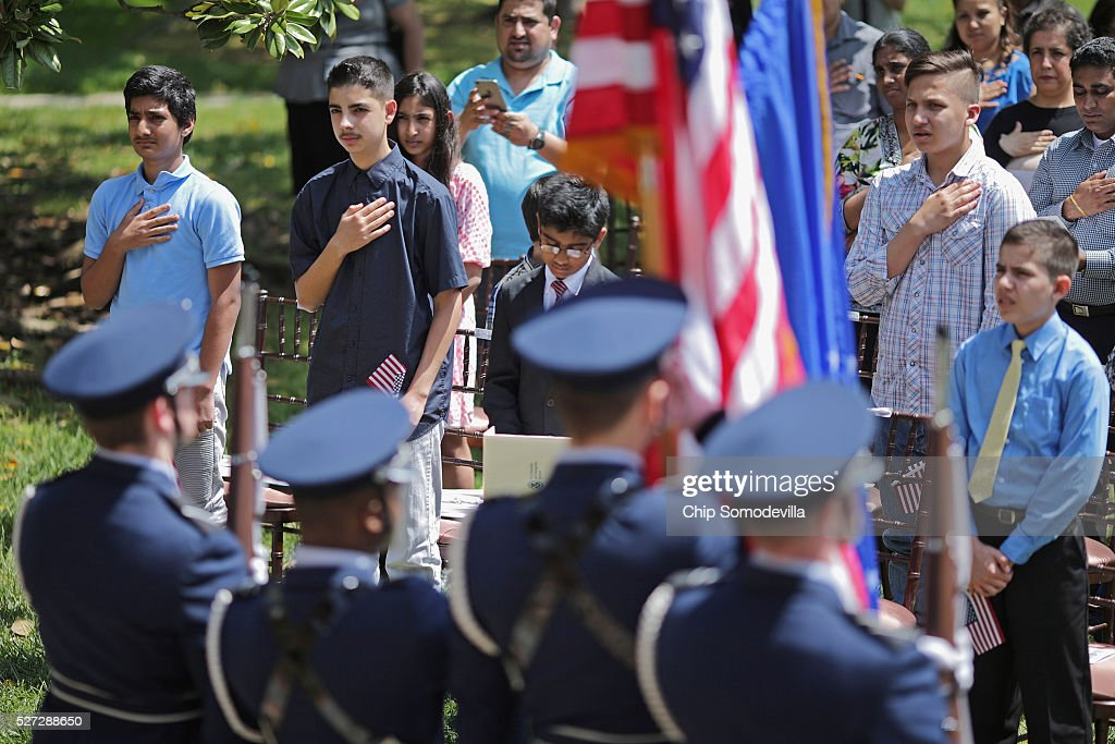 Children put their hands over their hearts during the singing of The Star-Spangled Banner during a childrens citizenship ceremony at President Lincoln's Cottage at the Soldiers' Home May 2, 2016 in Washington, DC. Twenty one children from 19 countries, including Syria, South Korea and El Salvador, became new United States citizens during the ceremony sponsored by the U.S. Citizenship and Immigration Services. President Abraham Lincoln and his family resided seasonally on the grounds of the Soldiers' Home to escape the heat and politics of downtown Washington, as did President James Buchanan before him and presidents Rutherford B. Hayes and Chester A. Arthur from 1885 to 1887.