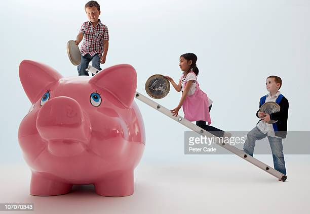 children putting euros into giant piggy bank
