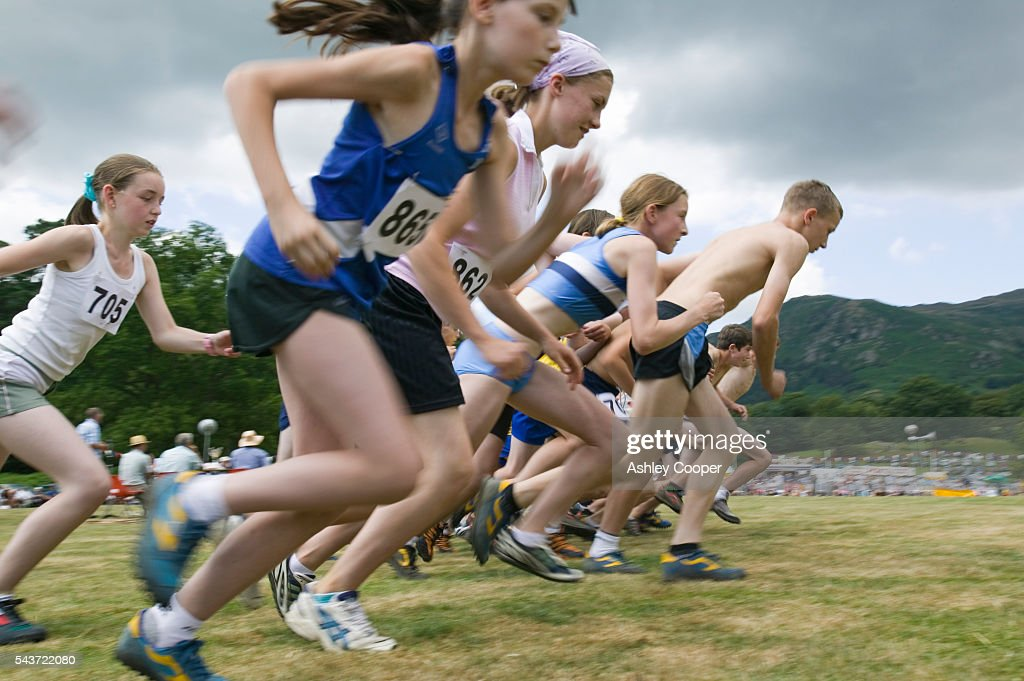 Children race off the starting line during the Fell Race event a cross country running competition at the annual Ambleside Sports competition at...