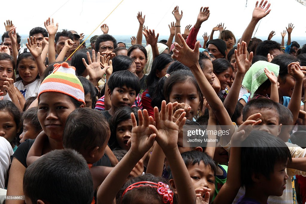 Children raise their hands as they welcome Ismael Mangudadatu, governor in the southern Philippine province of Maguindanao, during his first visit on September 19, 2012 in Datu Hoffer. The town is named after late Hoffer Ampatuan, one of the sons of Andal Ampatuan Sr. who was killed in shootout. Ampatuan Sr. is the alleged mastermind in the world's worst political mass murders on November 23, 2009 where Mangudadatu's wife, relatives and 30 journalists were massacred.