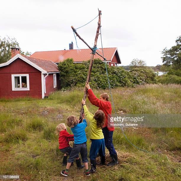 Children raising maypole