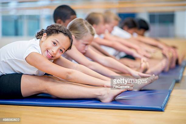 Children Reaching for Their Toes