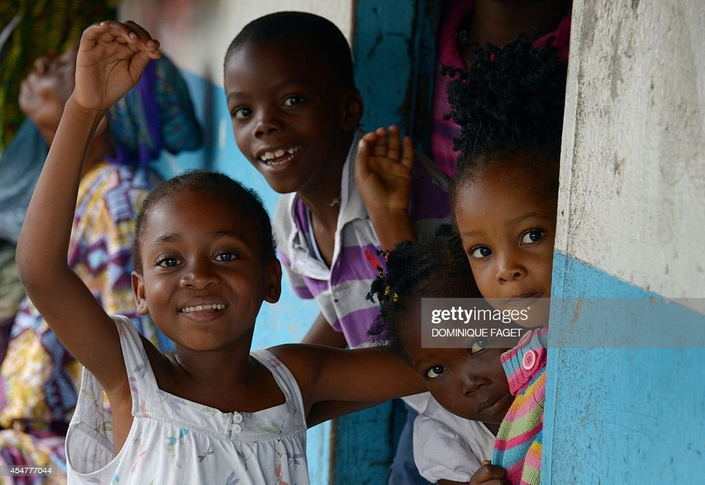 Children react on September 6 2014 during a World Food Program food distribution in Monrovia's West Point slum The death toll from the Ebola epidemic...