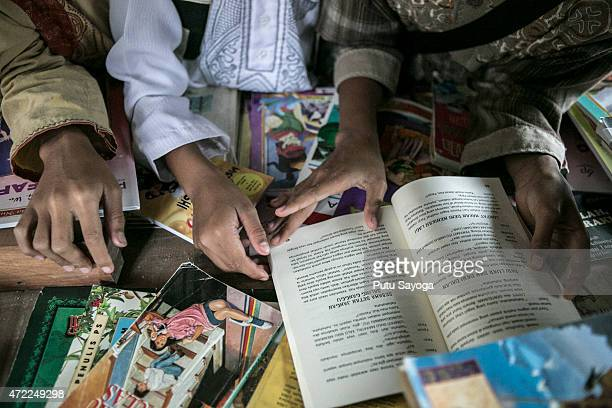 Children read book at Miftahul Huda Islamic elementary school on May 5 2015 in Serang Village Purbalingga Central Java Indonesia Ridwan a horses...