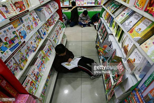 Children read books at a bookshop on February 9 2007 in Chongqing Municipality China Both in the city and the countryside reading is increasingly...