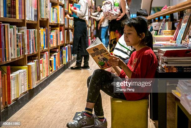 Children read books in Fangsuo Book Store an independent book store opened in 2015 at the underground level of the Tai Koo Li commercial streets...
