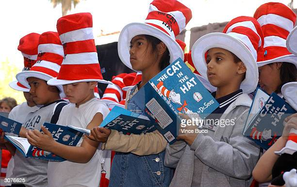 Children read from 'The Cat in the Hat' book at a ceremony honoring the late children's book author Dr Seuss with a star on the Hollywood Walk of...