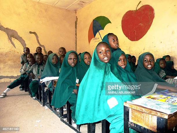 Children read from the Koran on May 23 2014 in a classroom of the Future Prowess Islamic Foundation School in the northeastern Nigerian city of...