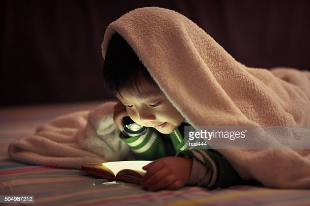 Children read in bed