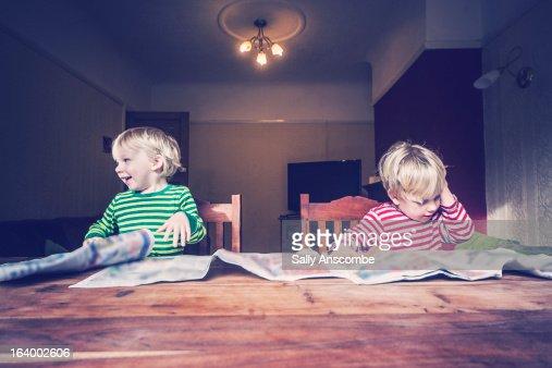 Children reading newspapers : Stock Photo