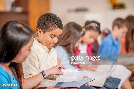 Children Reading Scripture Together