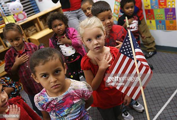 Children recite the Pledge of Allegiance at the beginning of the school day at the federallyfunded Head Start school on September 20 2012 in...