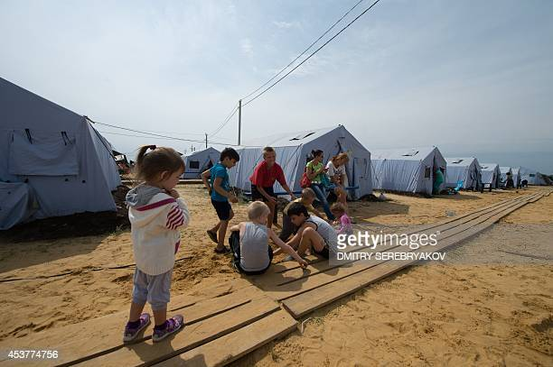 Children refugees from eastern Ukraine play in a refugee camp near the Russian city of Donets'k Rostov region about 15 kilometers from the...