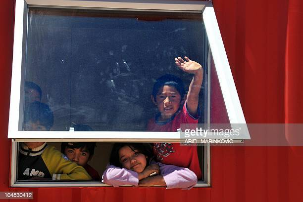Children relatives of the 33 trapped miners play inside the new module which will be used as a school room at the Esperanza encampment at the San...