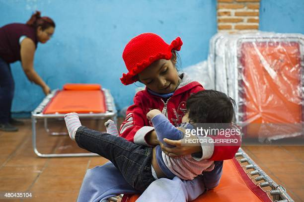 Children remain at a refuge in San Marcos Jalisco State Mexico on July 11 after being evacuated due to the eruption of the Fire volcano Western...