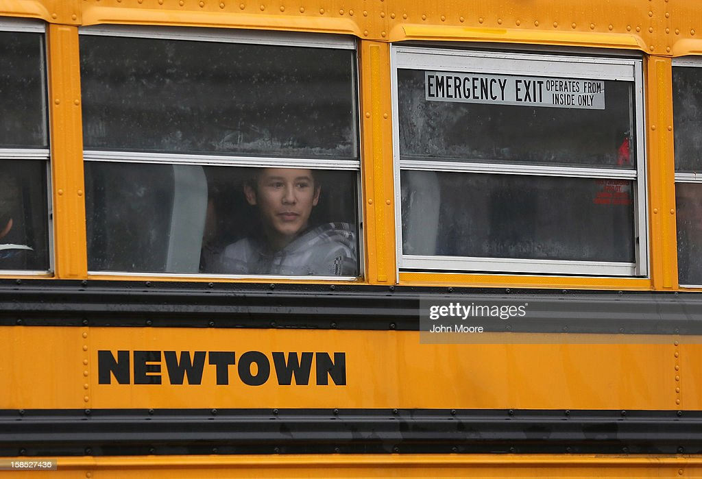 Children return to school on December 18, 2012 in Newtown, Connecticut. Four days after 20 children and six adults were killed at Sandy Hook Elementary School, most students in Newtown returned to school. Children at Sandy Hook Elementary will attend a school in a neighboring town until authorities decide whether or not to reopen Sandy Hook.