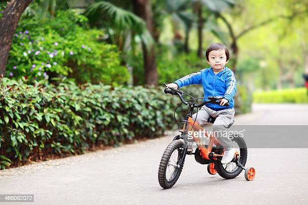 Children ride a bike