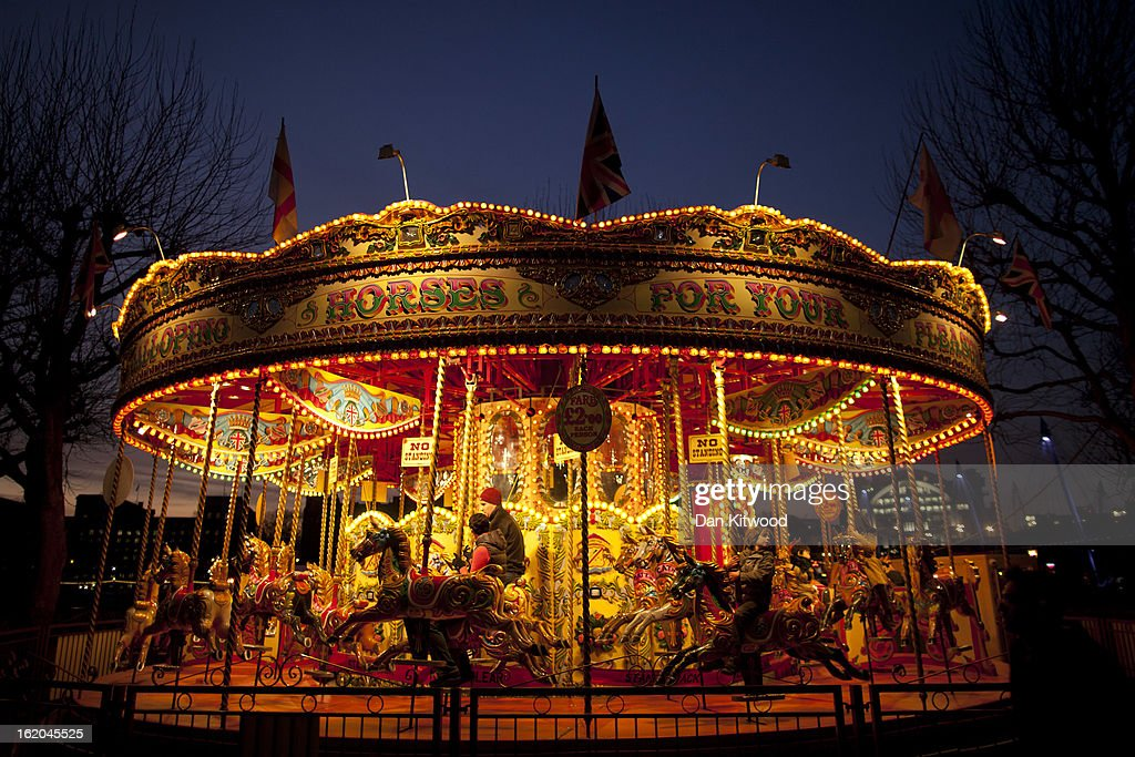Children ride a carousel on London's Southbank on February 18, 2013 in London, England.
