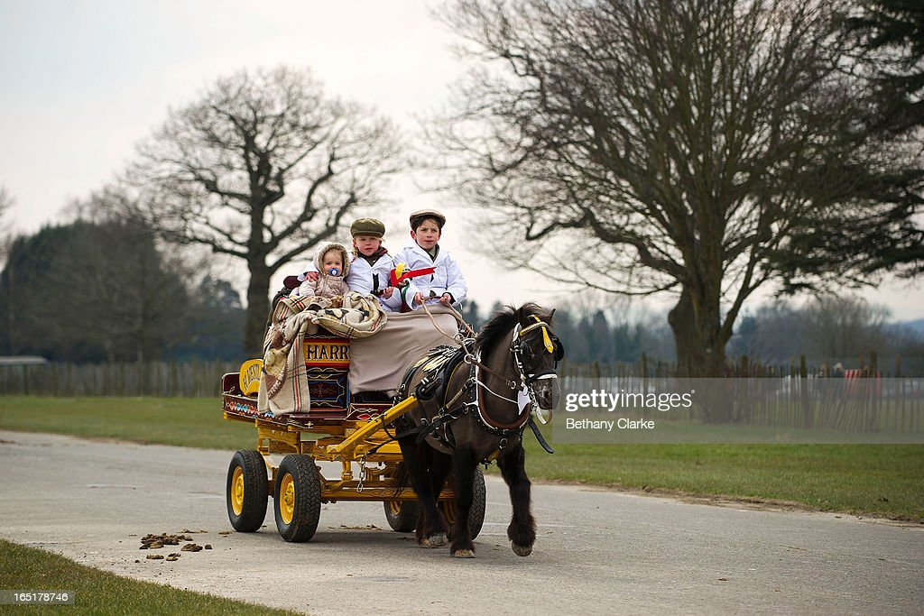 Children ride a horse drawn carriage during the horse parade on April 1, 2013 in Ardingly, United Kingdom. The Parade is an amalgamation of two traditional parades, the London Cart Horse Parade, founded in 1885 and the London Van Horse Parade, founded in 1904. The objectives of these parades was to improve the general condition and treatment of London's working horses and to encourage drivers to take a humane interest in the welfare of their animals. There is a wide variety of breeds of animal ranging from donkeys to Dutch Friesians and Gelderlander's, to magnificent heavy horses.