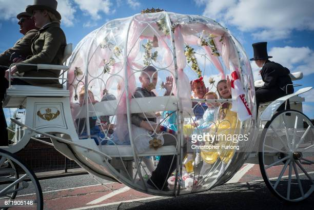 Children ride in a Cinderella coach during the Manchester St George's Day parade through the streets on April 23 2017 in Manchester England Various...