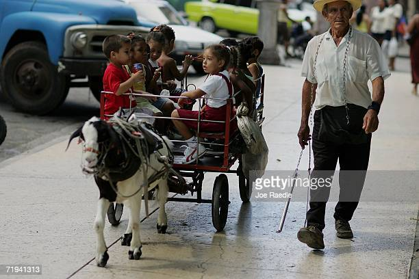 Children ride in a goat drawn cart September 17 2006 in Havana Cuba The island nation still waits for the first appearance of President Fidel Castro...