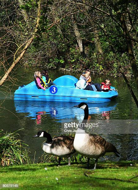 Children ride on a pedalo in Battersea Park on April 9 2008 in London England After a spell of cold weather and snow over the weekend the sun is...