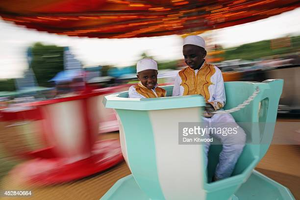 Children ride on tea cups during an Eid celebration in Burgess Park on July 28 2014 in London England The Muslim holiday Eid marks the end of 30 days...