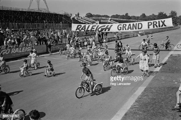 Children ride Raleigh Bikes for a television commercial at the 'Raleigh Grand Prix' held at Crystal Palace London UK 3rd September 1964