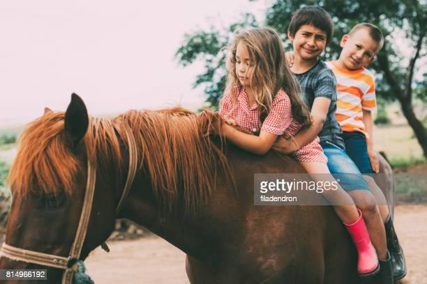 Children riding a horse
