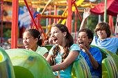 Children riding a roller coaster