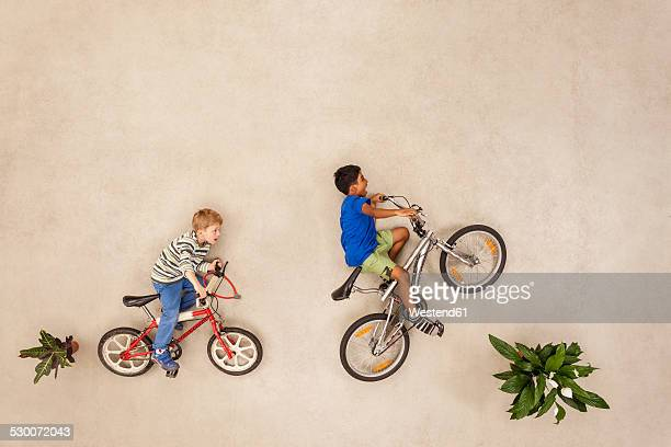 Children riding bicycle in park