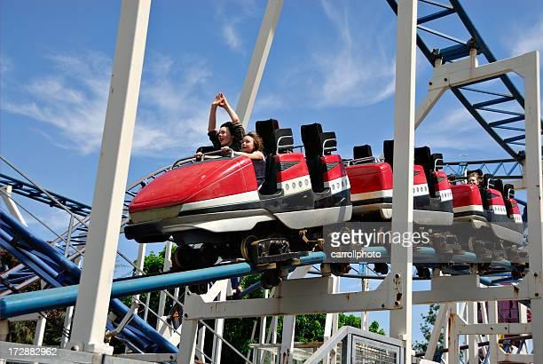 Children riding rollercoaster