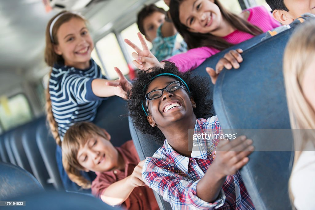 Children riding school bus : Stock Photo