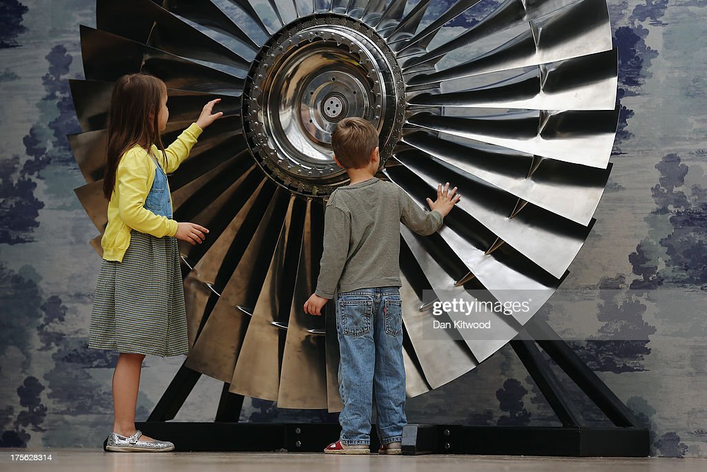 Children Riva (left) and Elial Lemanski turn the blades of a Rolls Royce fan at Christie's Auction House on August 5, 2013 in London, England. The fan makes up part of the 'Out of the Ordinary' sale at Christie's Auction House, and is expected to fetch between £60,000 - £80,000 GBP when it goes on sale on September 5, 2013.