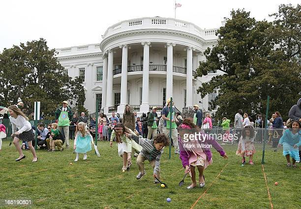 Children roll eggs during the annual Easter Egg Roll at the White House April 1 2013 in Washington DC Thousands of people are expected to attend the...