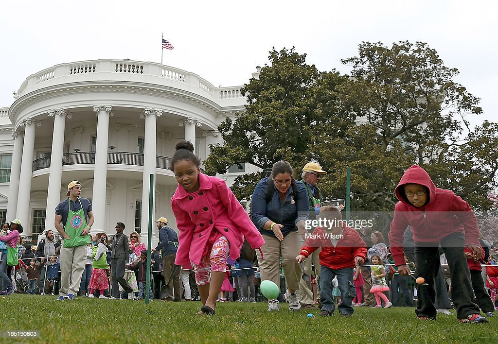 Children roll eggs during the annual Easter Egg Roll at the White House April 1, 2013 in Washington, DC. Thousands of people are expected to attend the 134-year-old tradition of rolling colored eggs down the White House lawn that was started by President Rutherford B. Hayes in 1878.