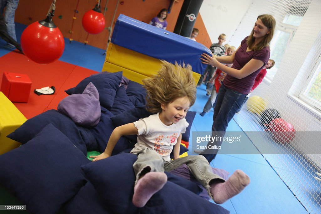 Children romp in the 'rubber room' at the 'Arche' youth center in Marzahn-Hellersdorf district on October 5, 2012 in Berlin, Germany. The Arche (which means Ark) is a Christian-based facility that provides children of all ages with a hot lunch, help with homework, arts and play facilities and in general a welcome place to come to in Marzahn-Hellersdorf district in east Berlin, a district with high levels of unemployment and social problems. An employee said up to 90% of the children come from challenged families and that many arrive at Arche illiterate.