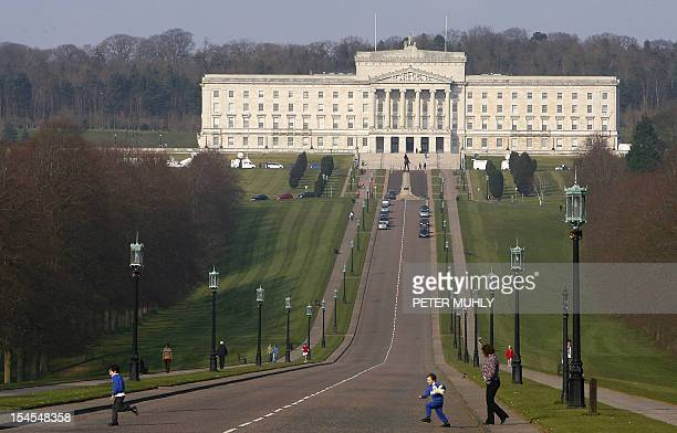 Children run across the Prince of Wales road in front of the Stormont Assembly building in Belfast Northern Ireland 26 March 2007 An accord between...